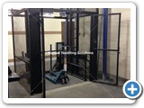 Goods Lift, with maximum working load 500kg, enclosed in a self-supporting mesh shaft.